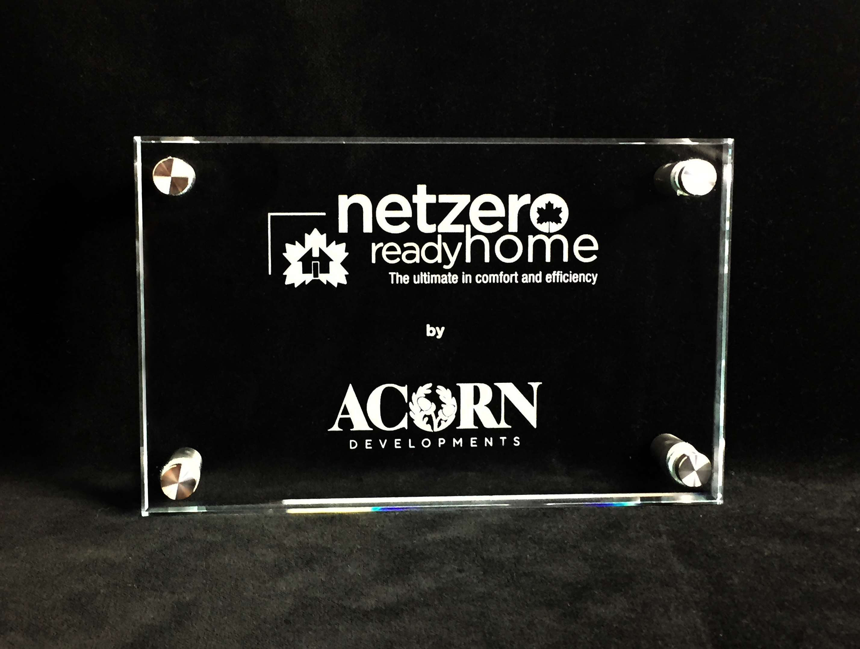 custom-award_unique_certification-program_glass_stainless-steel-standoffs_net-zero_wall-plaque_north-america